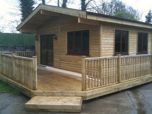 A log cabin office with railings